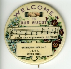 "I bought this button off Ebay. I really like it because of the shaking hands, the Welcome, the use of ""Auld Acquaintance"" and the fact that the lodge is identified."