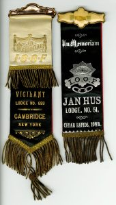 These are definitely mourning ribbons. Two of the tennets of the Odd Fellows are