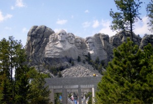 My parents live in Iowa. During one of my visits to see them I decided to drive to Mt Rushmore to add some excitement to my visit. According to AAA it's a 12 hour drive. It took me two days to get there but I was in no hurry. This is the entrance. It was a cold, overcast day.