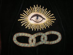 That's the eye of God and three links. I know this is machine made but it's pretty wonderful work.