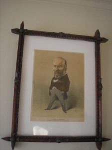 Hanging above her on the wall is our martyred president -- James A. Garfield. It's a Puck image.