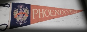 I took this picture at work. I put it on a bookcart and then rolled the bookcart under a skylight. (The pennant wouldn't fit on my scanner.) There is a Phoenixville, Pennsylvania which is located 28 miles northwest of Philadelphia. I suspect that's where this pennant comes from.