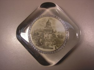 It's a paperweight with an image of Grant's Tomb.
