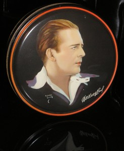 Wallace Reid. It's unfortunate he had that drug problem. He's quite enjoyable in the movies I've seen him in despite his addiction.This is a Beutebox Canoco tin. They were used to store candy or cosmetics.