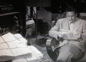 Figure 3: Joe (William Holden) reads Norma's 1200 page script. That's a lot of writing in front of him!