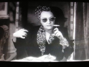 Figure 2: Norma (Gloria Swanson) watches Joe read her script. She doesn't appear to be in the mood for any negative criticism.  (Screen capture)