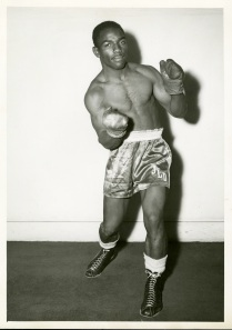 "There was a lot of information on the back of this photo. The boxers name is James ""Mutt"" Goodwin. The photo was taken by Commercial Studios Photographers on November 6, 1955. The studio was on Franklin Street in Oakland, California. According to Box Rec, Goodwin was born on July 16, 1938. He was a middle weight. He lived in Richmond, CA. He was born in New Orleans and his record was: won 19 (KO 5), lost 5 (KO 0), draws 3."