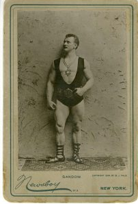 This is Sandow. He was one of the world's first famous bodybuilders.  Usually, he's wearing less in photos so this image is tasteful as far as Sandow goes.  There's a good book about him titled, Sandow the Magnificent : Eugen Sandow and the beginnings of bodybuilding by Chapman, David