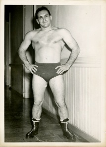 Another wrestler. His name is written on the back. It looks like Larry T. Hine.