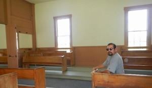 That's me in the Fellowship Meetinghouse. Evidently, men sat on one side and the women sat on the other side. Everyone sat in silence until they were moved to speak.