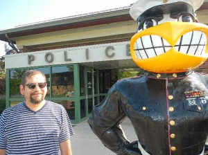 This Herky stands outside a police station. My shirt is wild.