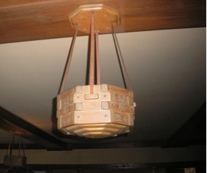 An unusual hanging light fixture in this second story bedroom.