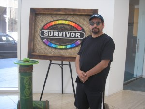That's me, Guillermo Luna, in front of the Survivor logo.