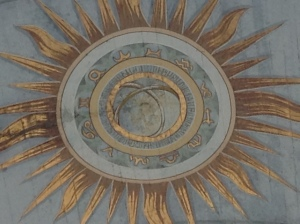 The zodiac sign within the arch.