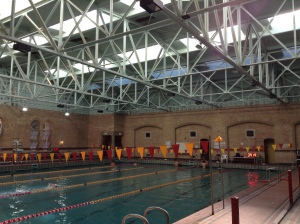 Inside the east wing of the building is a very large swimming pool.