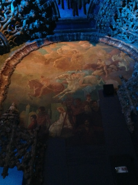 There are murals on both sides of the theater with silent film stars.