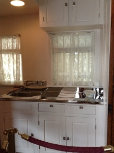 There was a kitchen on board too with a black cast iron stove to the left of the sink.