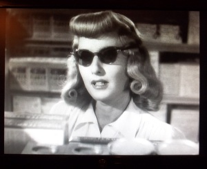 From Double Indemnity. Walter wants to get off the trolley car but Phyllis tells him they're riding it straight down the line -- together. (screen grab.)