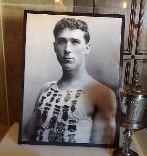 This early image of Hart is in the foyer. He won the cup and all the medals for speed-walking.