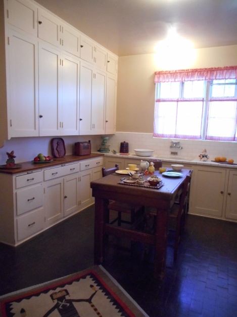 A glimpse of the kitchen. I wish I had those cabinets in my tiny bungalow.