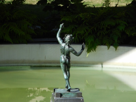 This a backside view of the guy frolicking in the water.